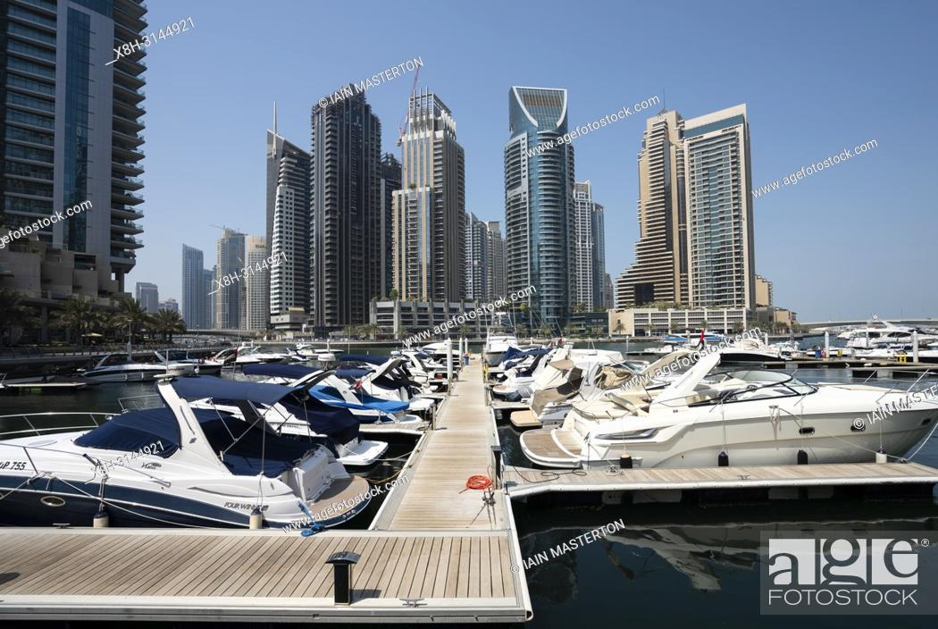 Stock Photo: Many high rise apartment towers and skyscrapers in Marina district of Dubai, UAE, United Arab Emirates.