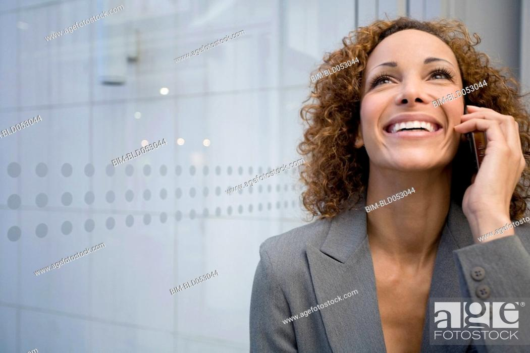 Stock Photo: African businesswoman talking on cell phone.