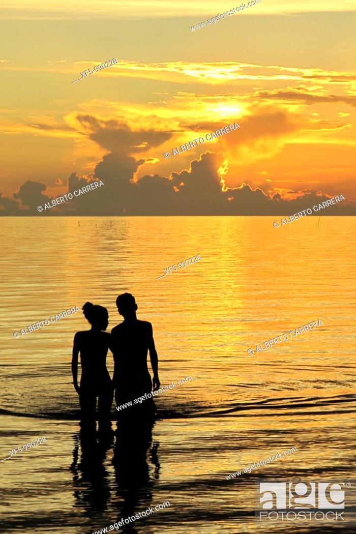 Stock Photo: Orange sunset and couple, Caribbean, Isla de la Juventud, Cuba.