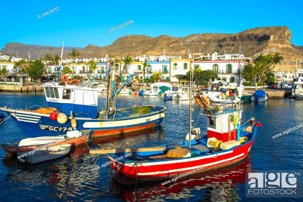 Stock Photo: colorfull little fishing boats in harbour of puerto de mogan, gran canaria, spain.