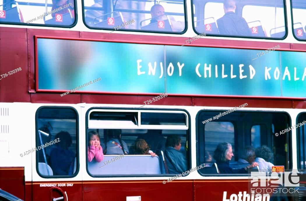 Stock Photo: Side of a bus with young girl leaning out the window. Edinburgh. Scotland. UK.