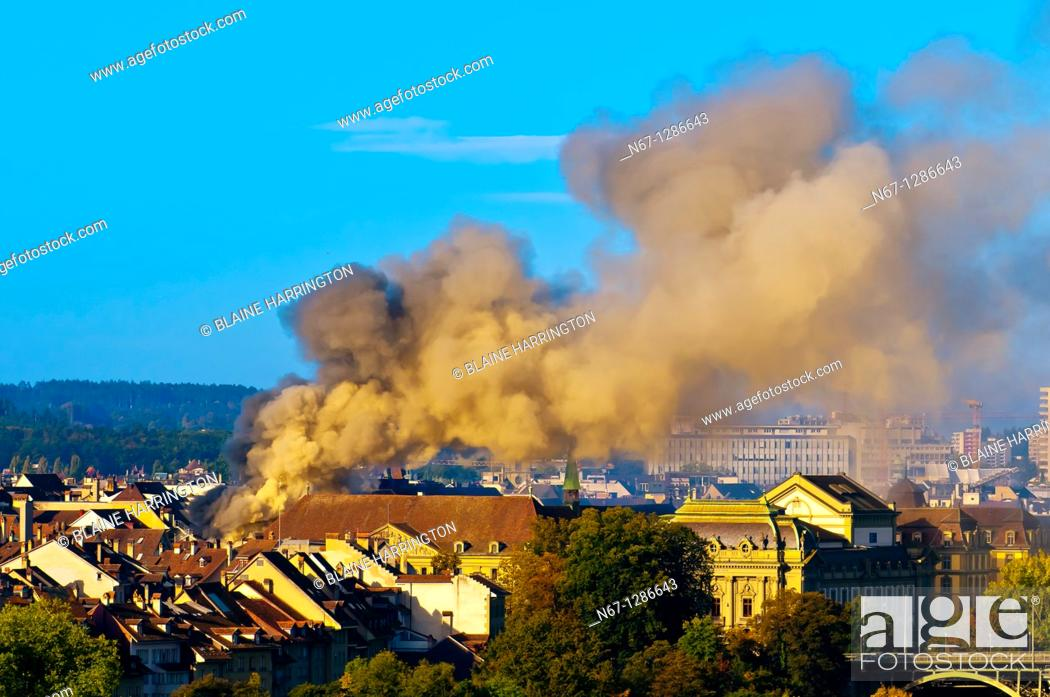 Stock Photo: A fire engulfs a building in the medieval city center of Bern, Canton Bern, Switzerland.