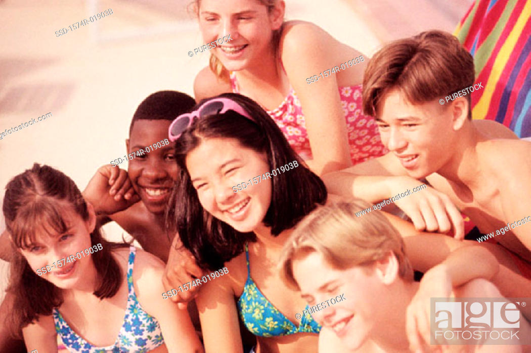 Stock Photo: Group of teenagers at the beach.
