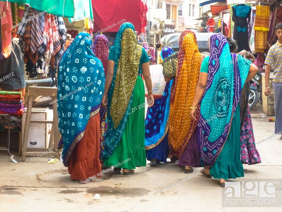 Stock Photo: group of women in colorful saris at street in Bhuj, Gujarat, India.