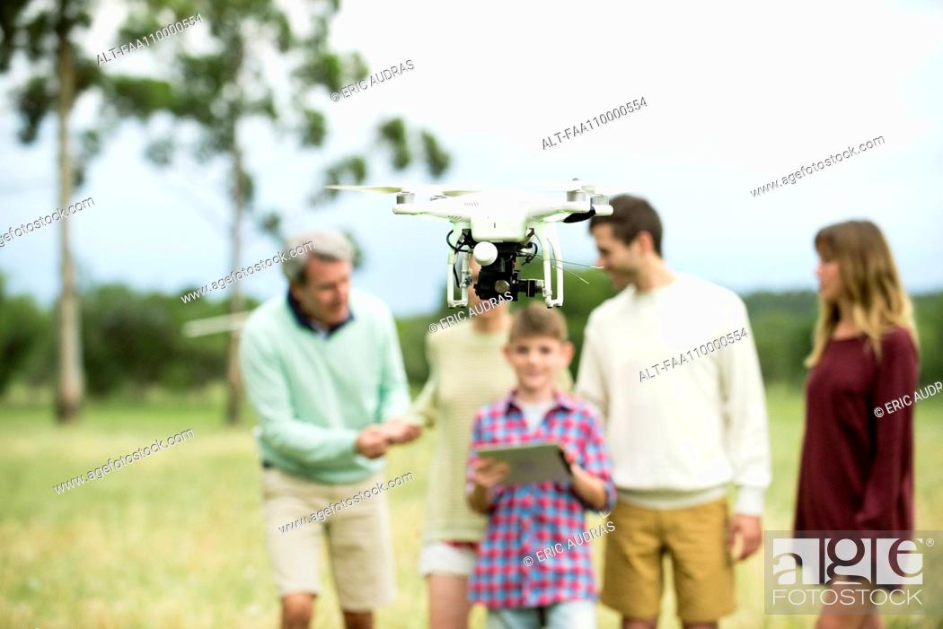 Stock Photo: Family playing with drone.
