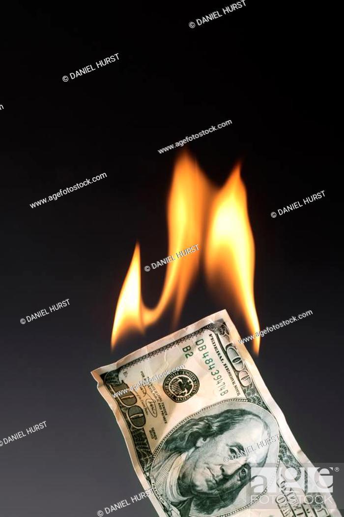 Stock Photo: Burning money.
