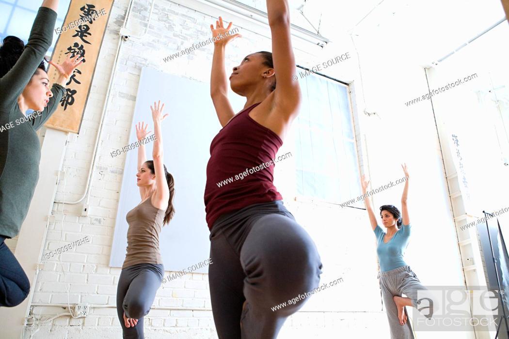 Stock Photo: Women practicing yoga.