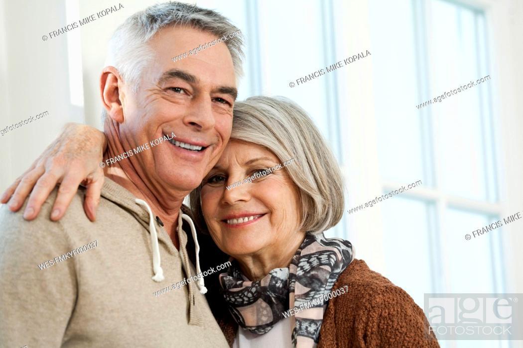 Stock Photo: Germany, Berlin, Senior couple smiling, portrait.