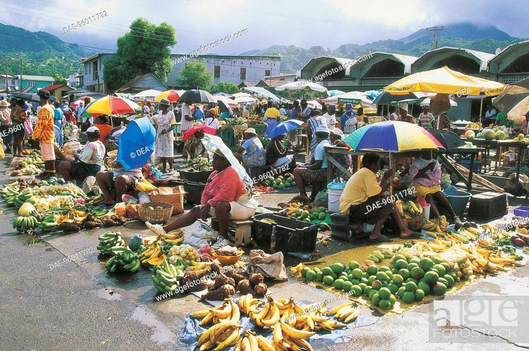 Stock Photo: Group of people at a market, Roseau, Dominica.