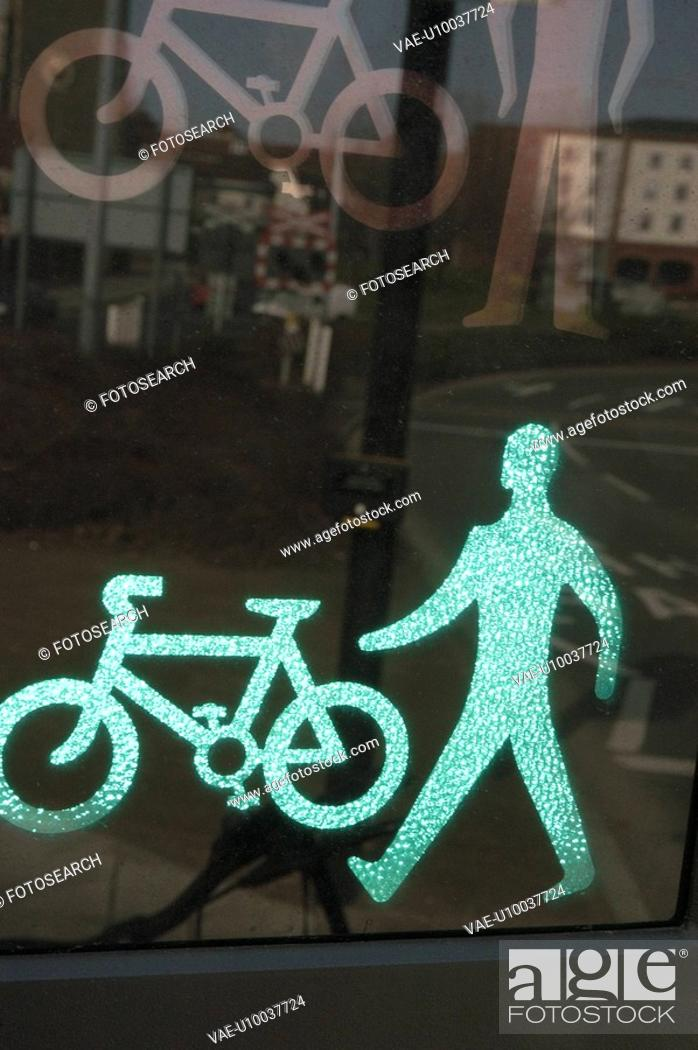 Stock Photo: Green traffic light display for pedestrians and cycles.