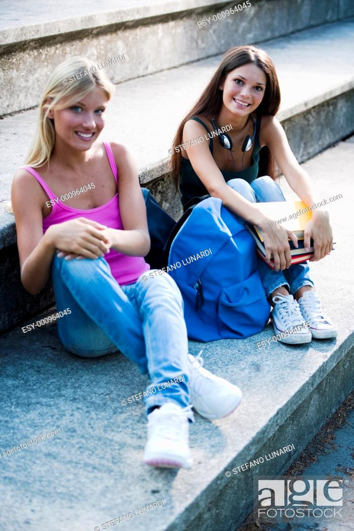 Stock Photo: Happy teenage girls with schoolbooks.