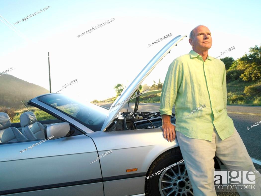 Stock Photo: Senior man by broken down car on roadside.