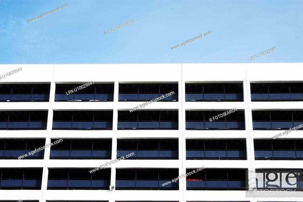 Stock Photo: Architectural detail of the upper floors of an NCP car park, UK.