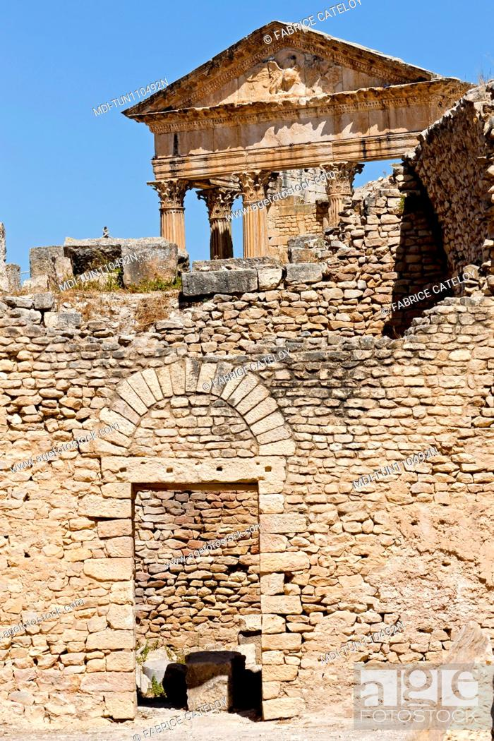 Stock Photo: Tunisia - Dougga - The Capitol from the Licinian Baths.