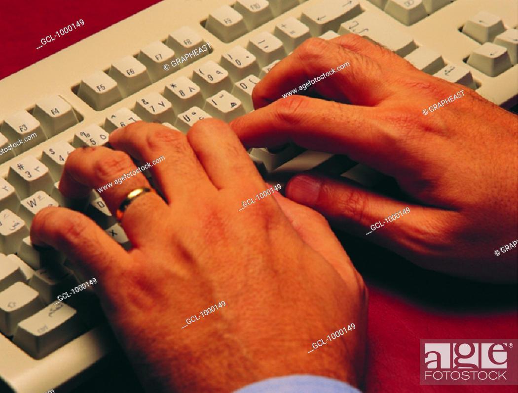 Stock Photo: Man typing on computer keyboard.