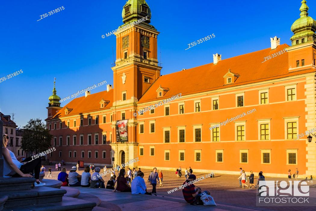Stock Photo: Tourists and locals relaxing on the Sigismund's Column stairs at sunset, Old Town. Warsaw, Poland, Europe.