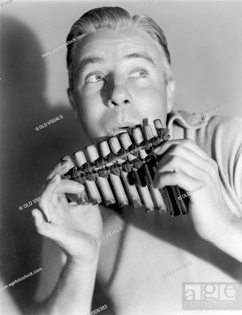 Stock Photo: Man playing a pan flute All persons depicted are not longer living and no estate exists Supplier warranties that there will be no model release issues.