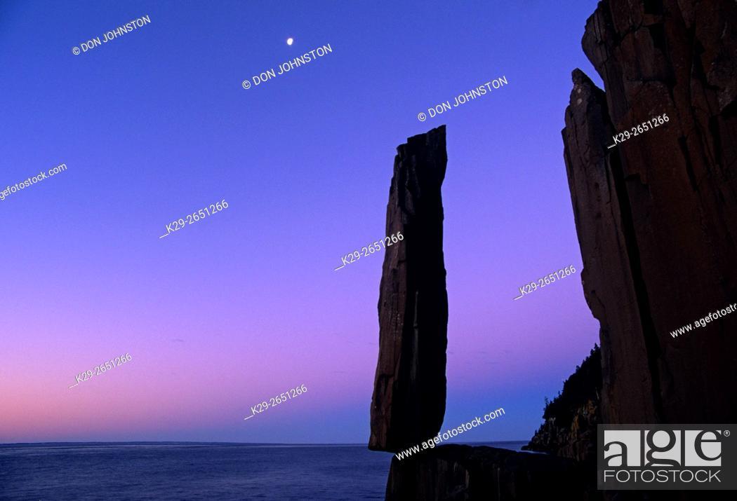 Stock Photo: Moon setting over Balancing Rock before dawn, Tiverton, Scotia, Canada.