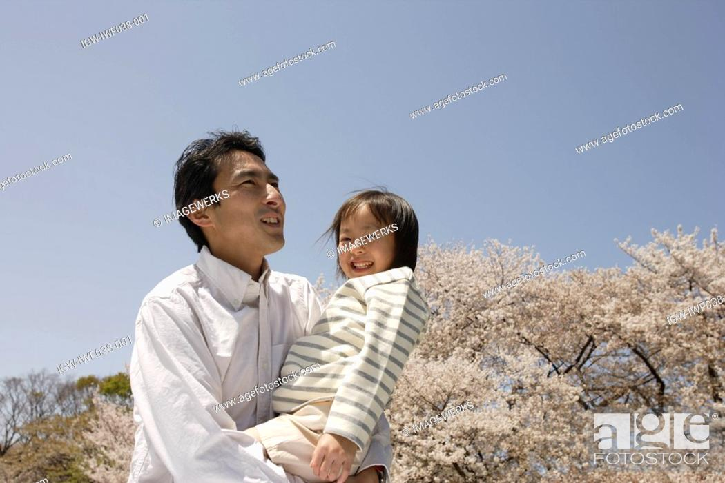 Stock Photo: Father carrying daughter.