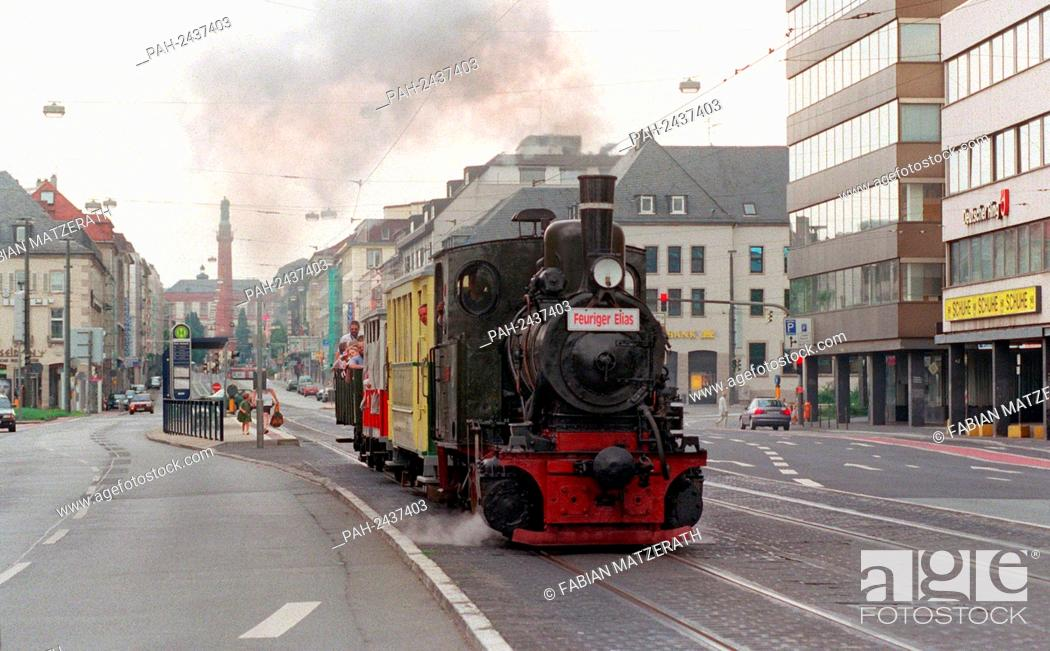 Stock Photo: On the rails of the tram ride this historic steam locomotive on 27 July 1997 by Darmstadt. On the occasion of the 100th anniversary of the electric tram in the.