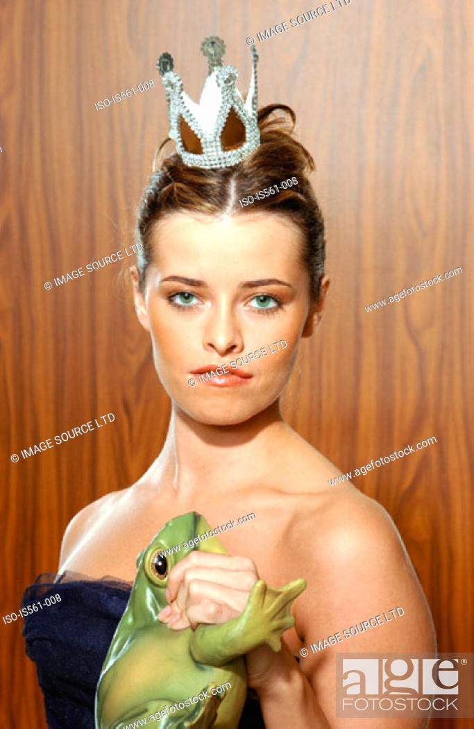 Stock Photo: Woman holding toy frog.