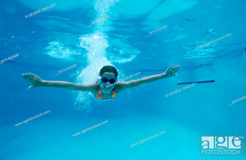 Stock Photo: girl swiming underwater.