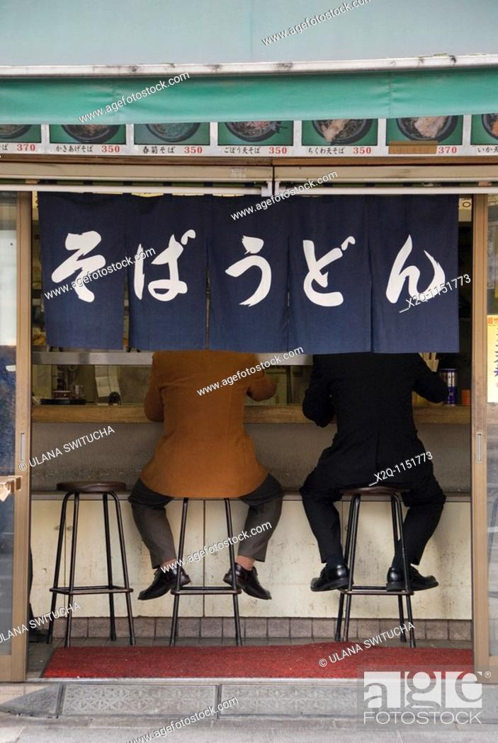 Stock Photo: Two men eating soba udon at a restaurant Tokyo Japan.