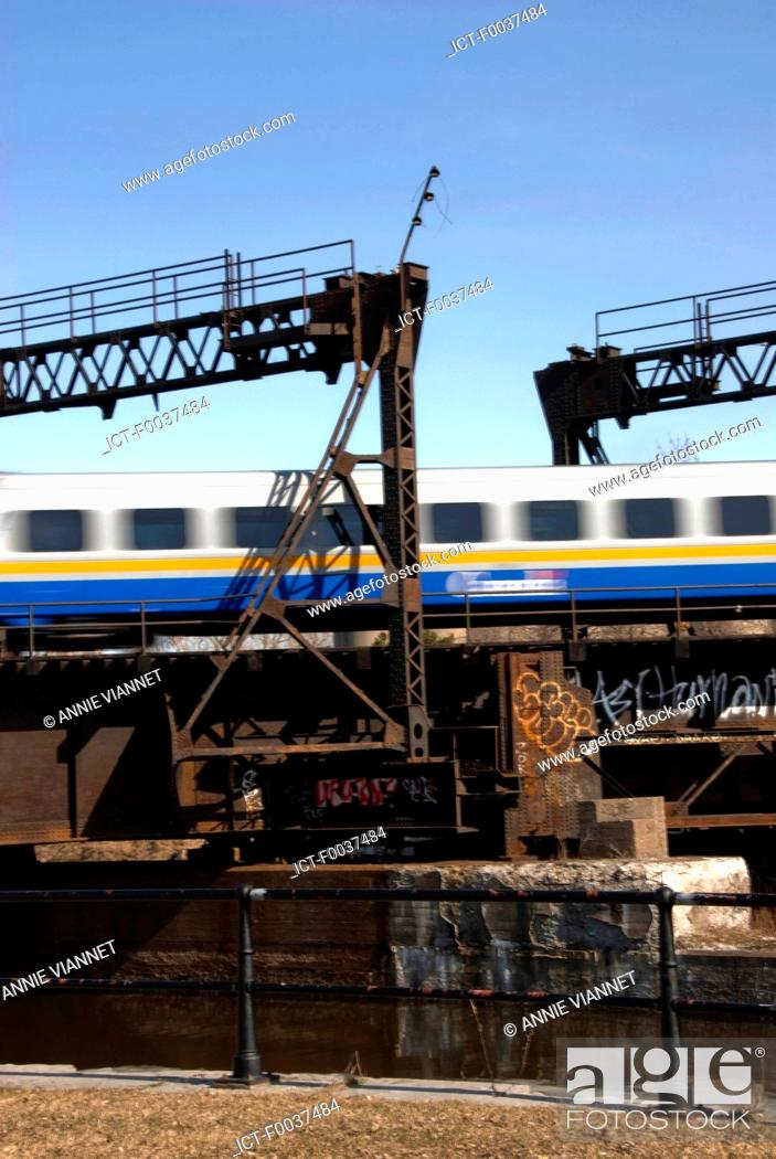 Stock Photo: Canada, Quebec, Montreal, Lachine canal, Peel, passing train.
