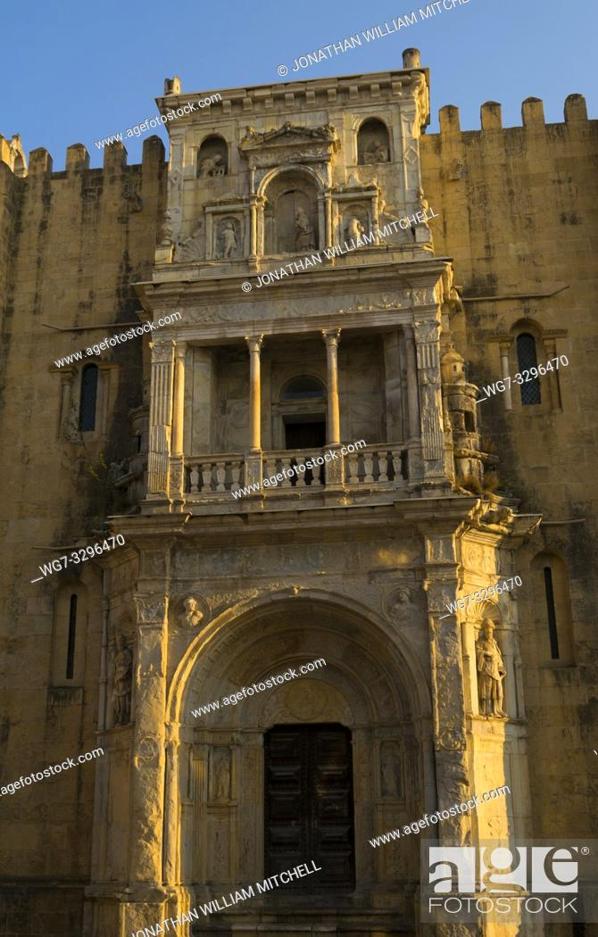 Stock Photo: COIMBRA, PORTUGAL - August 13, 2016: The northern facade of the Old Cathedral of Coimbra in the historic university city of Coimbra, Portugal.