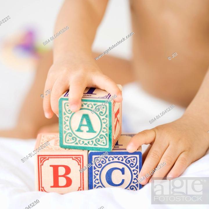 Stock Photo: Hispanic baby playing with blocks.