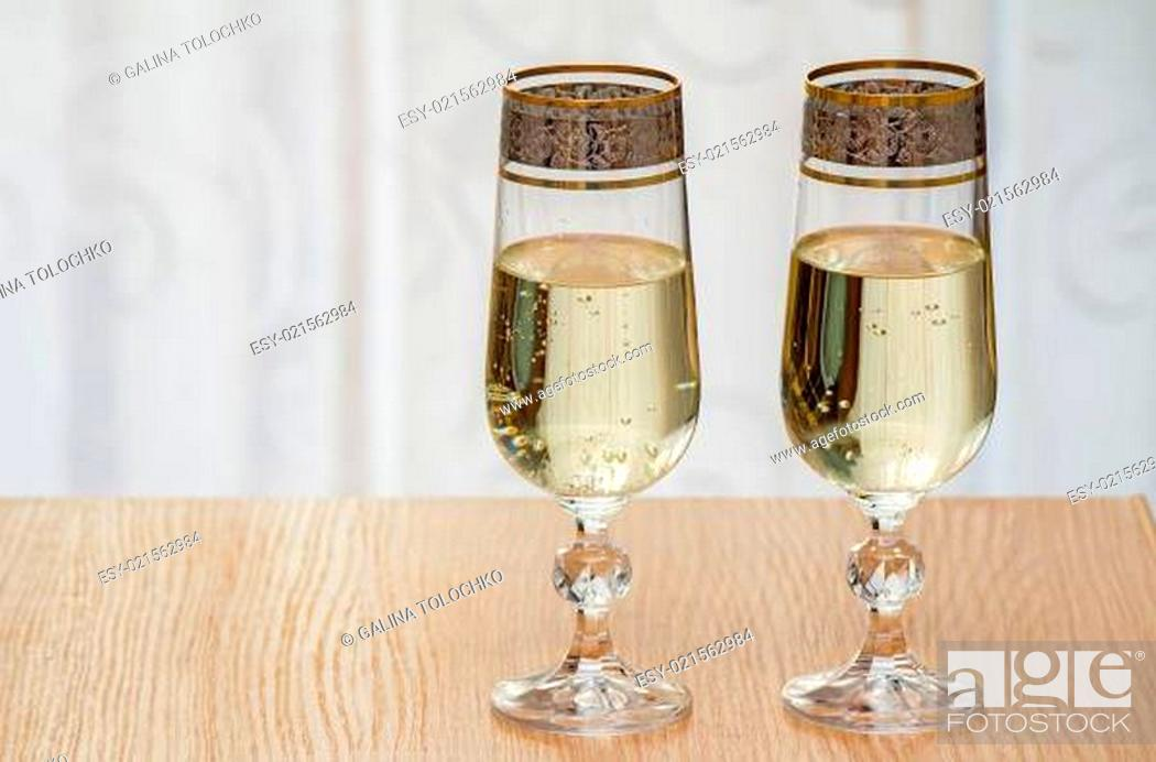 Stock Photo: Two champagne flute filled with champagne.