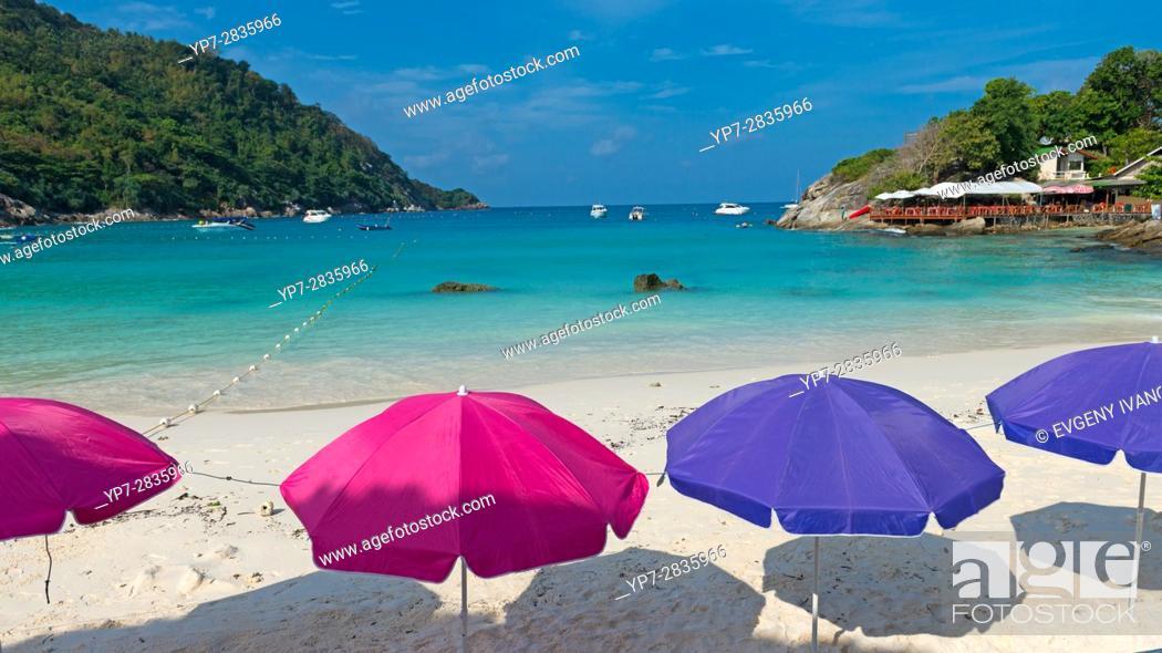 Stock Photo: Colorful beach umbrellas on idyllic beach of Raya island, Thailand.