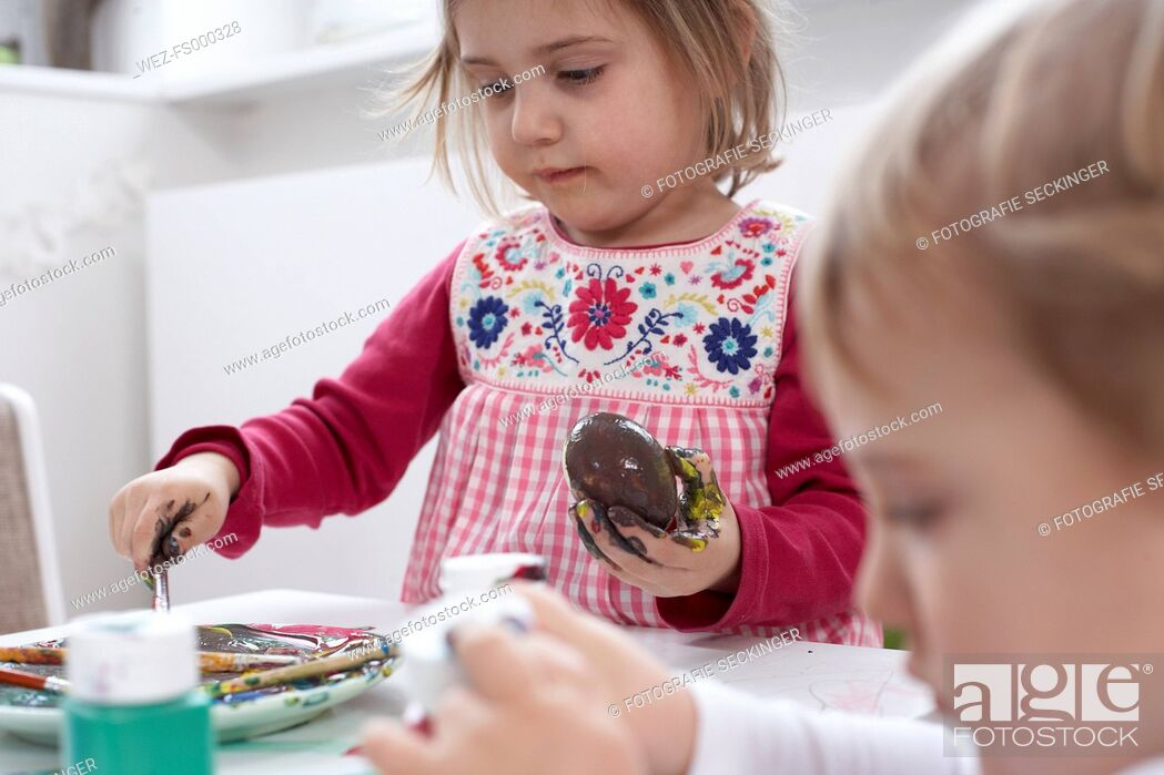 Stock Photo: Children painting Easter eggs.