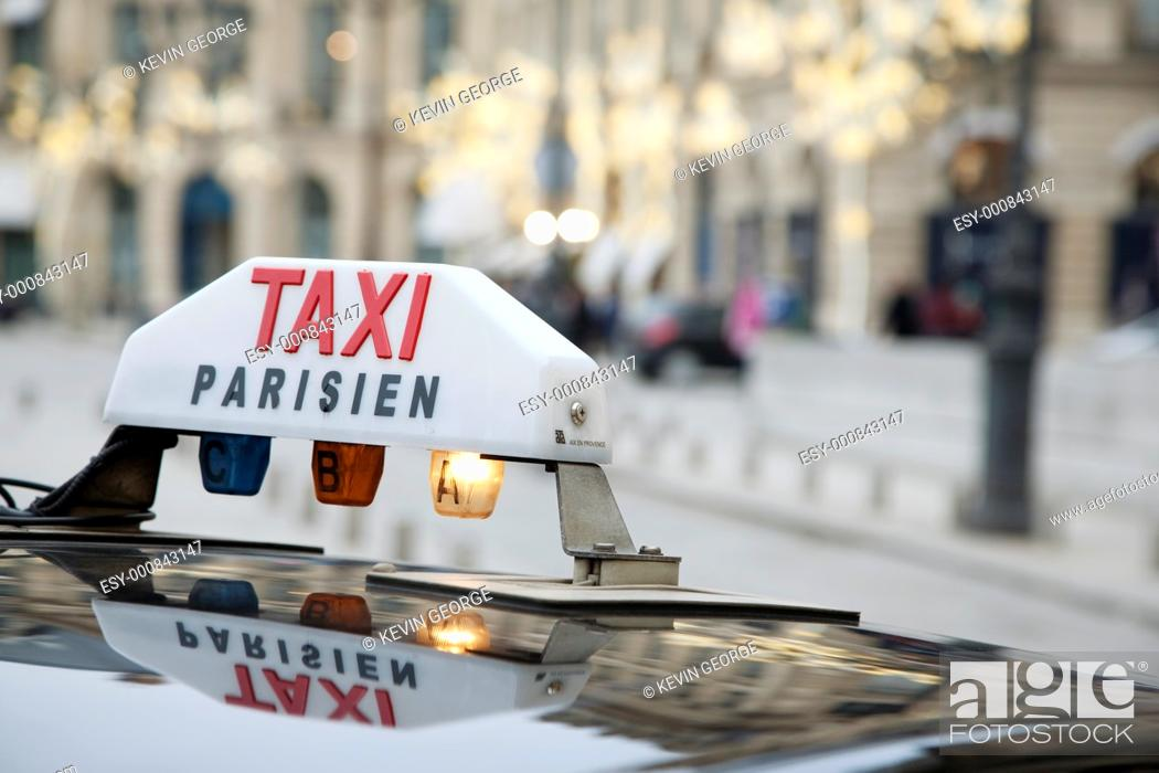 Stock Photo: Parisian Taxi with Christmas Decoration in Background.