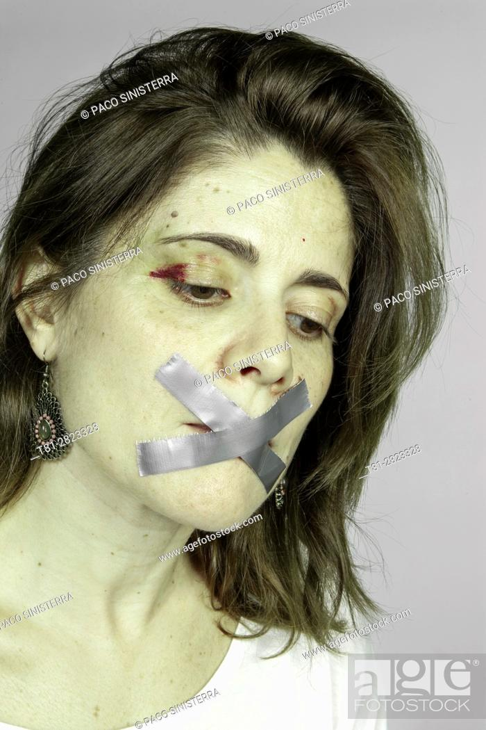 Stock Photo: silence of a battered woman.