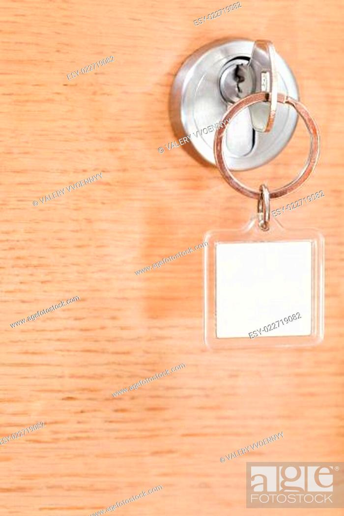 Photo de stock: key with blank square keychain in lock.