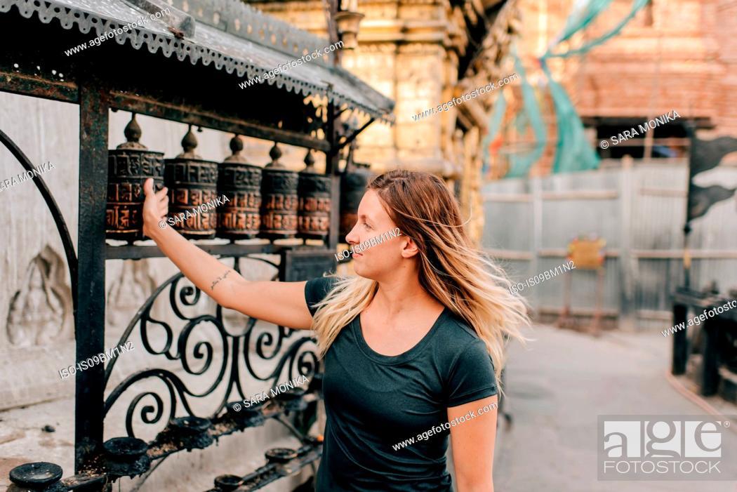 Stock Photo: Woman at Monkey Temple, Kathmandu, Nepal.