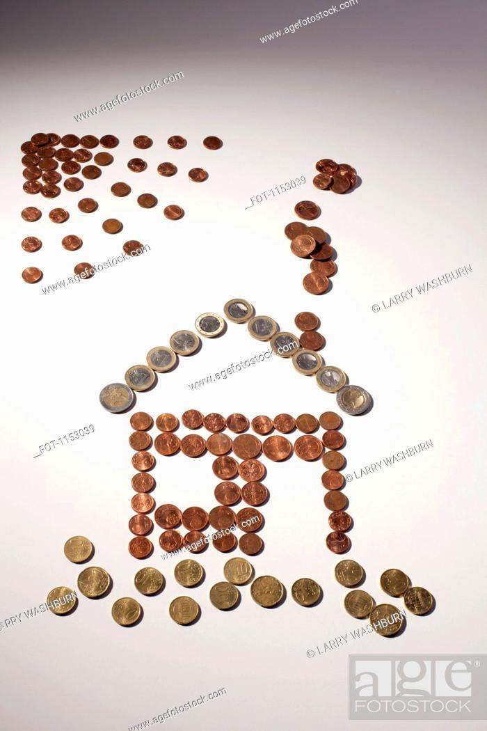 Stock Photo: European Union coins arranged into the shape of house and sun.