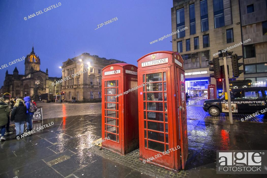 Stock Photo: The Royal Mile by dusk Edimburgh old town. Scotland, UK. Red telephone booths.
