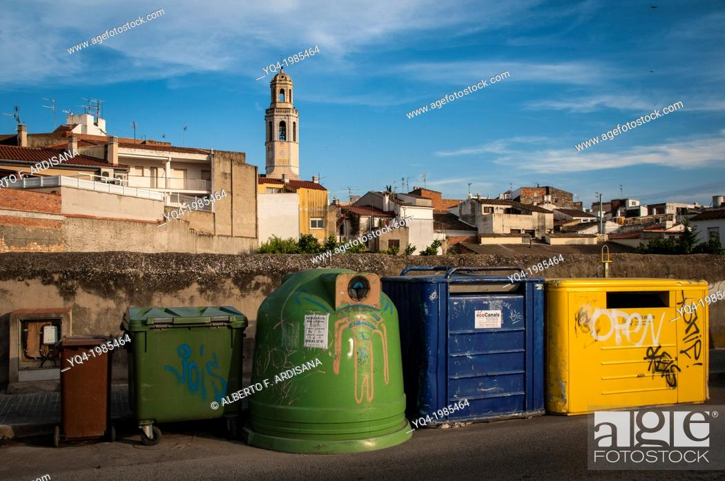 Stock Photo: Buckets to recycle garbage. the background, Cubelles Church, Catalonia.