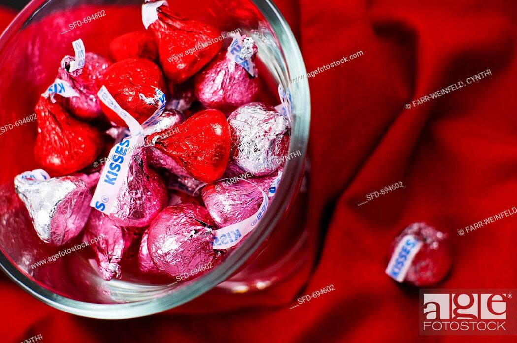 Stock Photo: Red, Pink and Silver Chocolate Kisses in a Glass Dish, From Above.