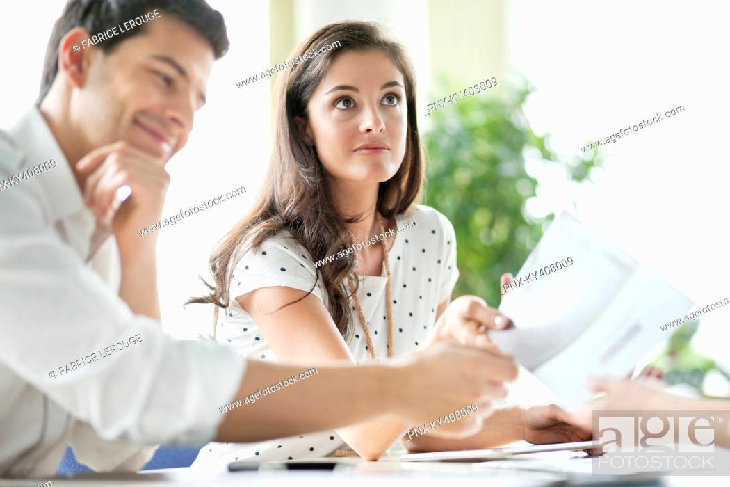Stock Photo: Business executives having a meeting in an office.
