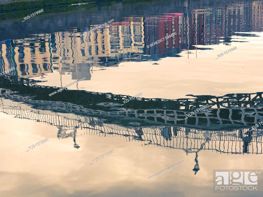 Stock Photo: Reflection of the Ha'penny Bridge in the River Liffey, Dublin, Ireland.
