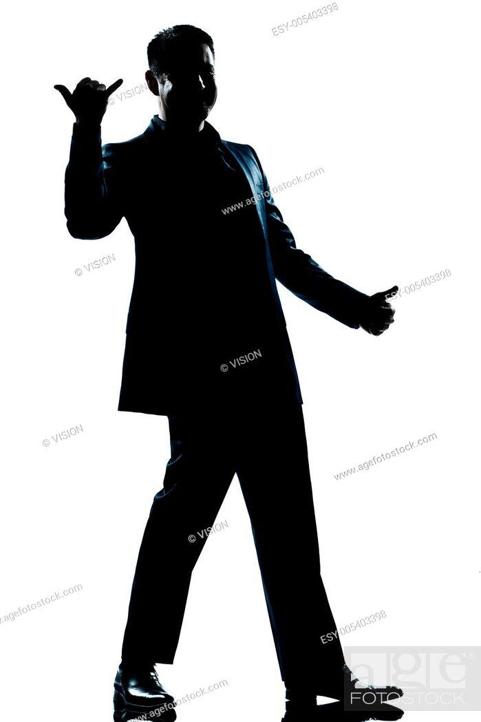 Stock Photo: one caucasian man happy saluting shaka sign full length silhouette in studio isolated white background.