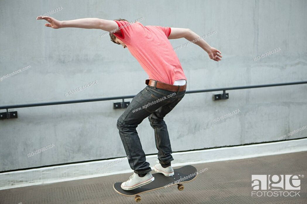 Stock Photo: Young man skateboarding.