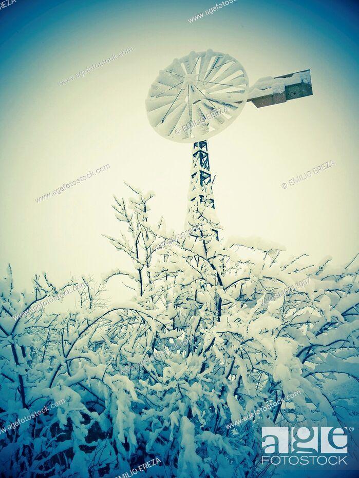 Stock Photo: Snowy windmill.