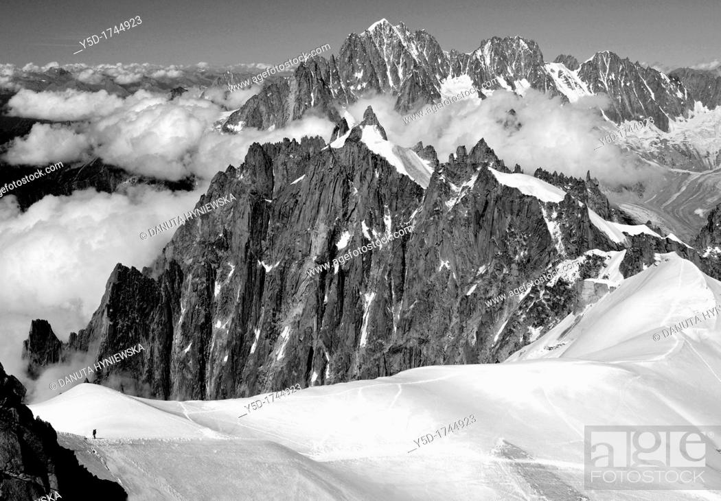 Stock Photo: lonely climber seen from Aiguille du Midi, next to Mt Blanc, French Alps, France, Europe.