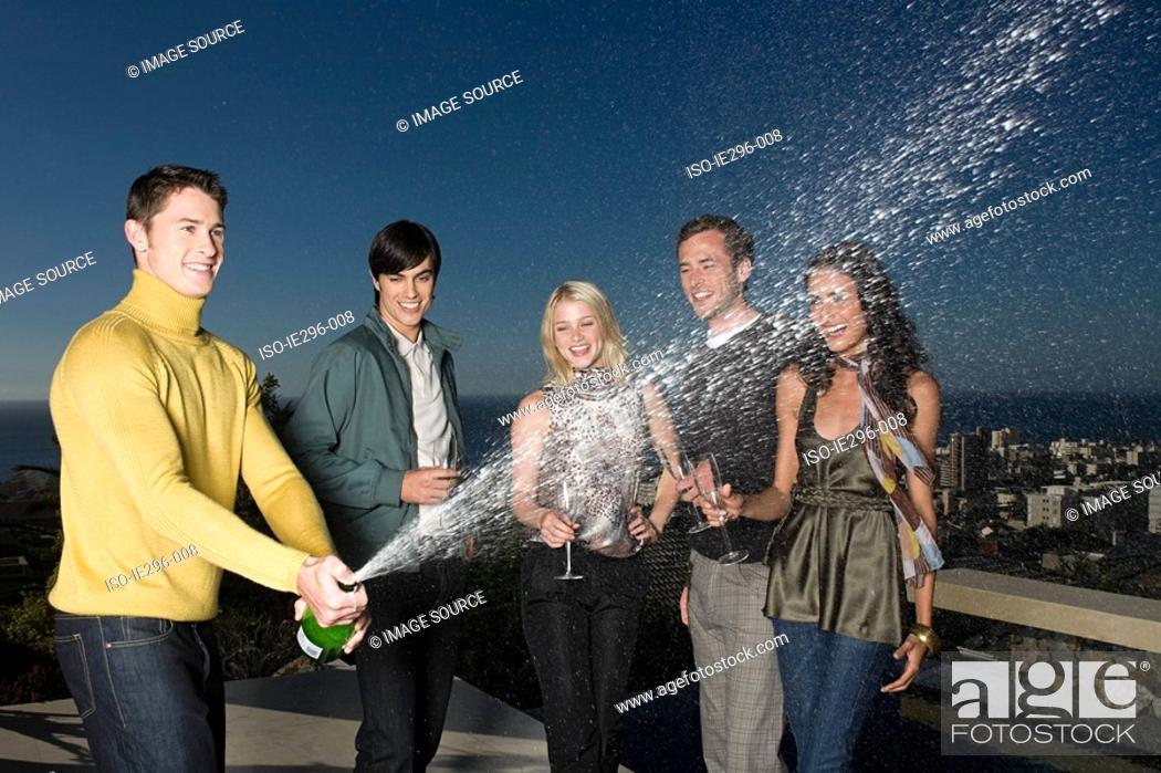 Stock Photo: Man spraying champagne.