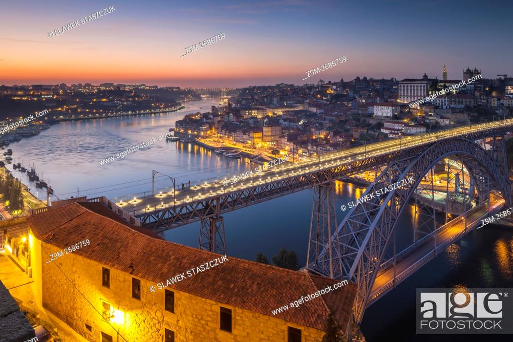 Stock Photo: Dusk at Luis I Bridge on river Douro, Porto, Portugal.