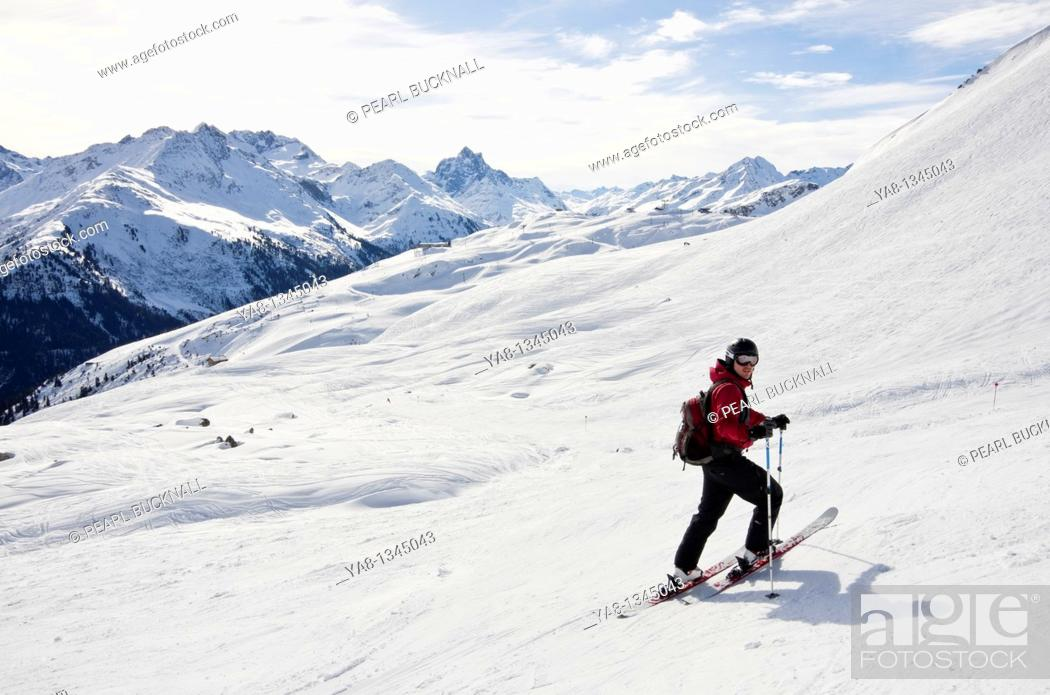 Stock Photo: St Anton am Arlberg, Tyrol, Austria, Europe  Skier on ski route 33 from Kapall in Austrian Alps  MR 11/04.